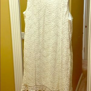 White sleeveless stretch dress with modest lace